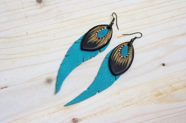 teal feather like earrings