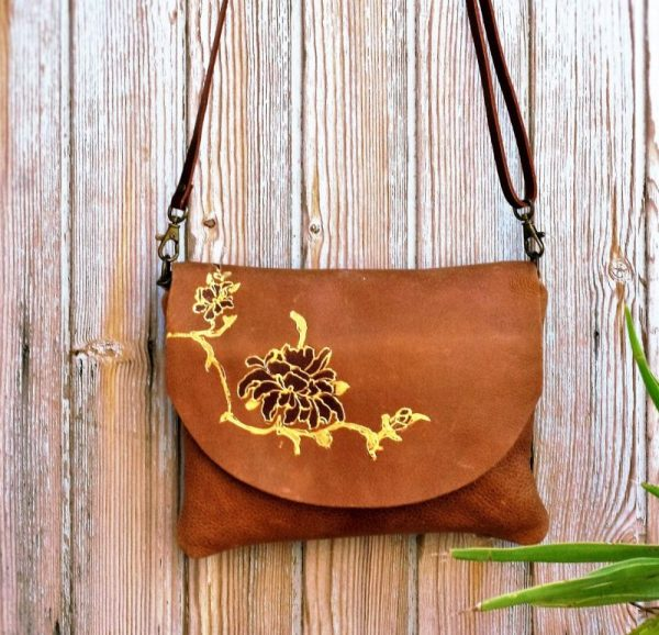 tan bag with flowers