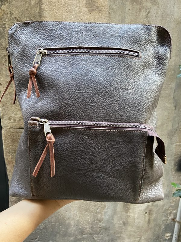 brown backpack with pocket