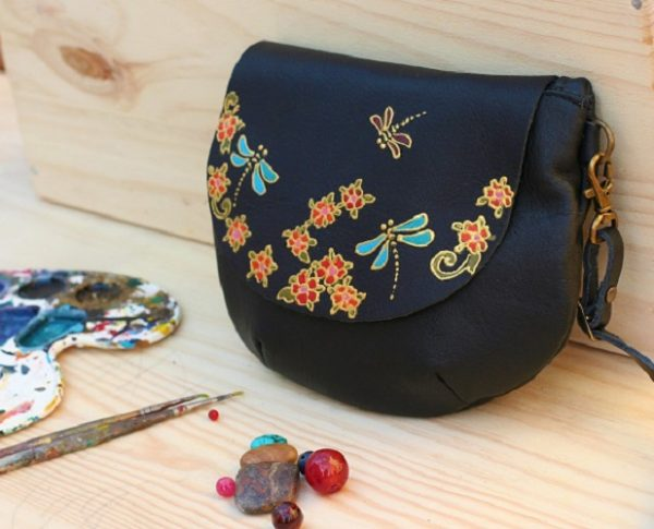 black round dragonfly bag