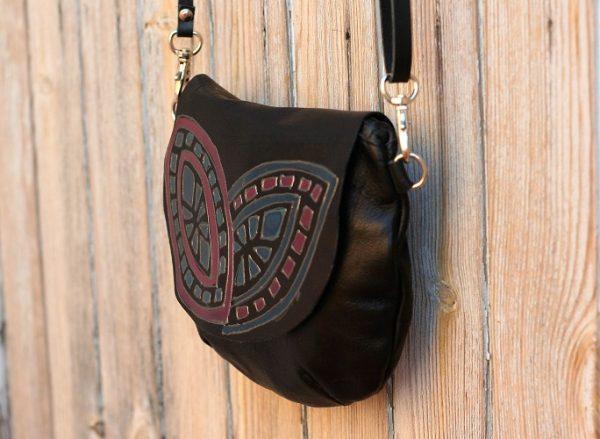 black round geometric bag