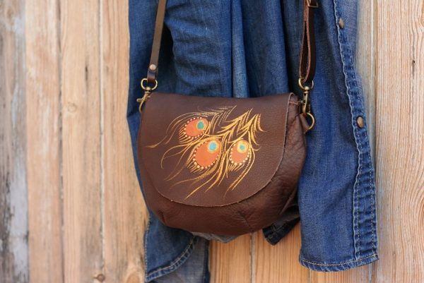brown round peacock bag