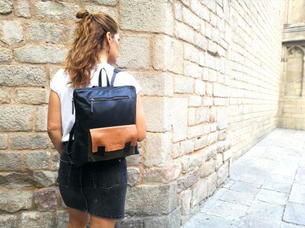 black backpack tan pocket