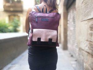 Goldrose pocket on a rosewood leather backpack
