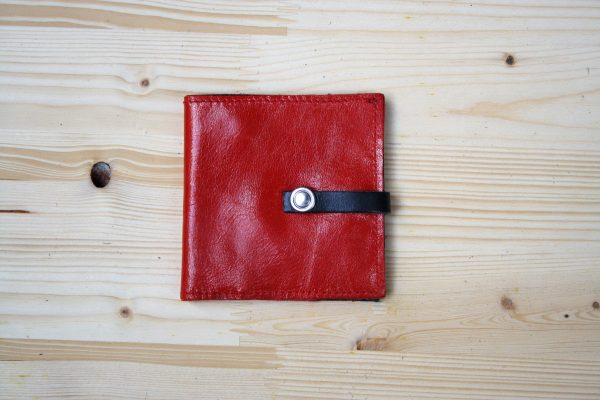 red and black london wallet