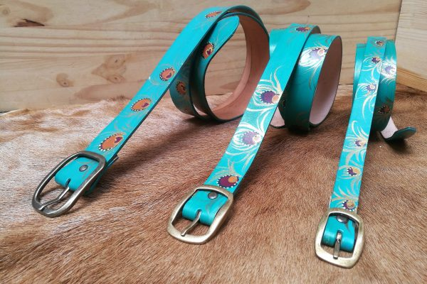 teal belts peacock