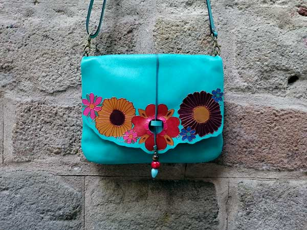 teal leather bag with flowers rossymina