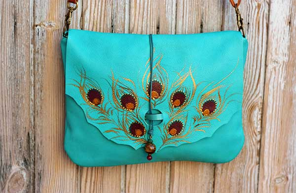 teal leather bag peacock feather Rossymina